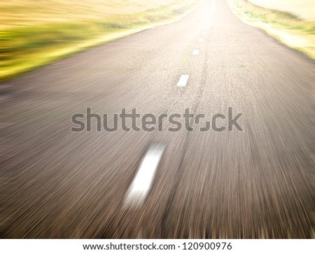 endless rural road in fast and quick traffic motion blur - stock photo