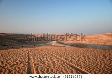 Endless sand dunes at sunset - Murzuq Desert, Sahara, Libya - stock photo