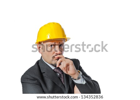 Energetic man happened on the work.  It puts on a helmet of protection.  Isolated on white background.  He thinks to a solution.