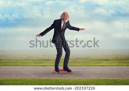 energetic senior man enjoying riding a skateboard
