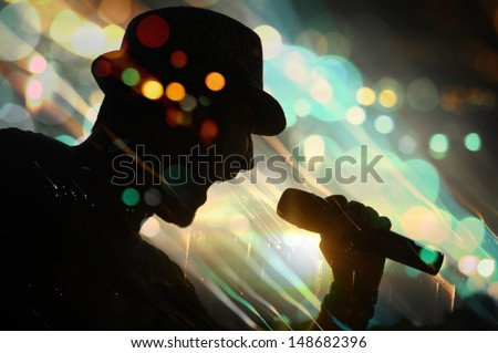 energetic singer. silhouette. - stock photo