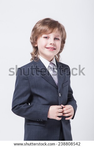 energetic young successful businessman in a classic suit smiling. - stock photo