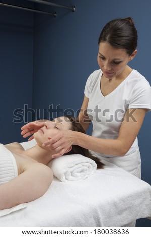 energizing facial massage - stock photo