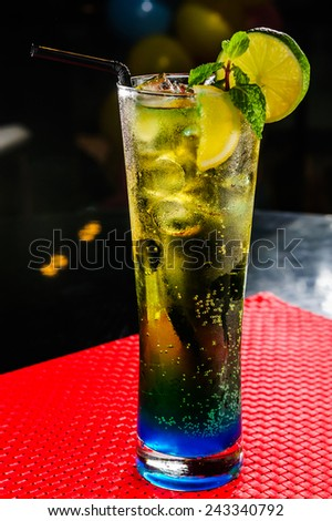 Energy cocktail topped with lime. - stock photo