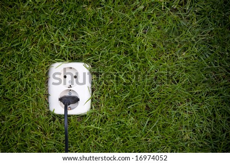 energy concept outllet in grass - stock photo