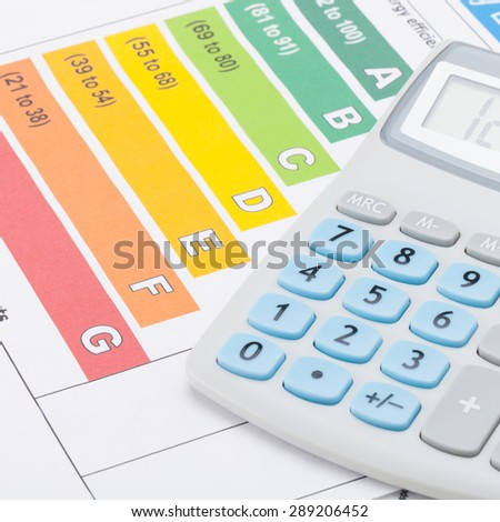 Energy efficiency chart and calculator - close up shot - stock photo