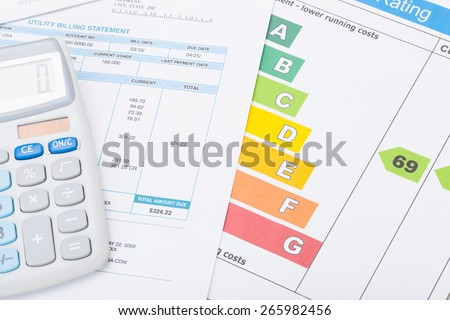 Energy efficiency chart, utility bill and calculator - stock photo