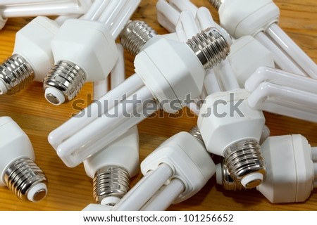 Energy efficient lightbulbs in a pile - stock photo