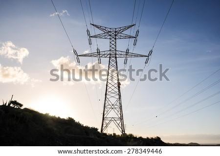 Energy Electricity Power Pylon on a Blue Sky - stock photo