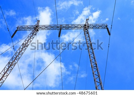energy pylon on the background of blue sky and clouds - stock photo