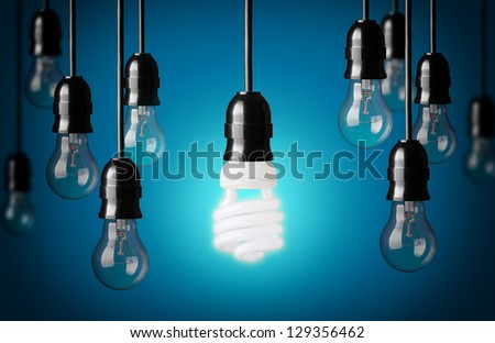 Energy saving and simple light bulbs.Blue background - stock photo