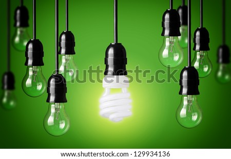 Energy saving and simple light bulbs.Green background - stock photo