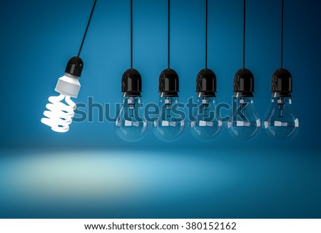 Energy saving bulb and row of incandescent bulb in perpetual motion