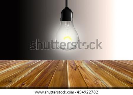 Energy saving concept A lamp that illuminates the background blank. - stock photo
