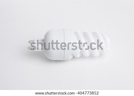 Energy saving fluorescent light bulb,  - stock photo