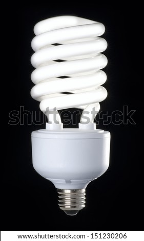 Energy saving fluorescent light bulb isolated on the black background - stock photo
