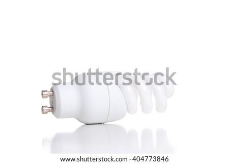 Energy saving fluorescent light bulb, isolated on white background. - stock photo