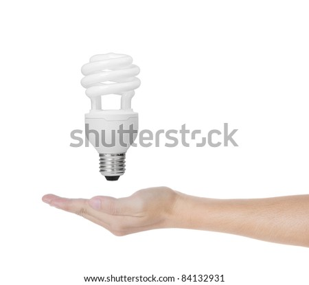 energy saving fluorescent spiral light bulb in hand isolated on white background - stock photo