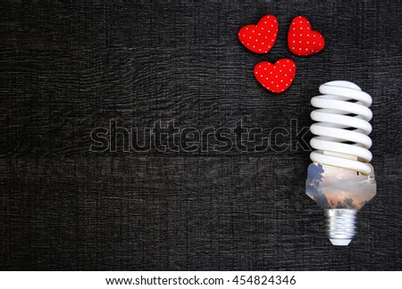 "Energy saving lamp and ""save energy"" word on wooden background. Concept for saving energy. Concept for eco-friendly. Concept for global warming. - stock photo"