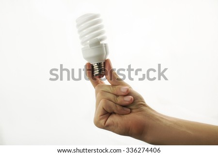 energy-saving lamp in hand isolated on white background - stock photo