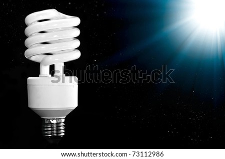 Energy saving lamp  on black background. - stock photo