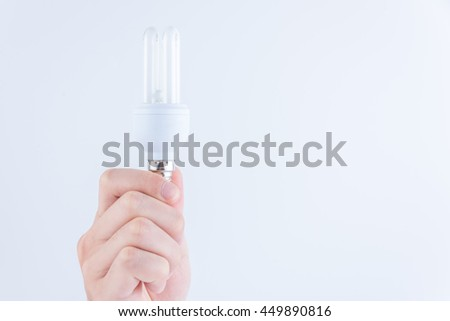 energy-saving lamps in hand isolated on white background