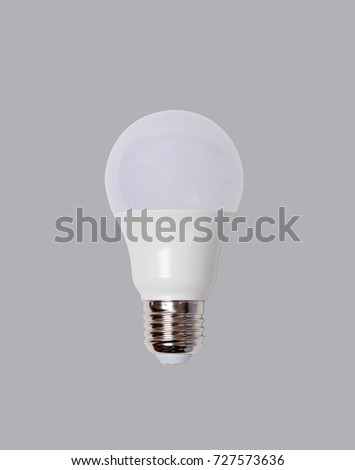 energy saving led bulb E27 closeup isolated on grey background