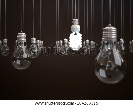 Energy saving light bulb among simple light bulbs. - stock photo