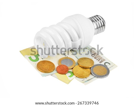 Energy saving light bulb and money on white - stock photo