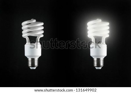 Energy saving light bulb on hand (energy saving concept) - stock photo