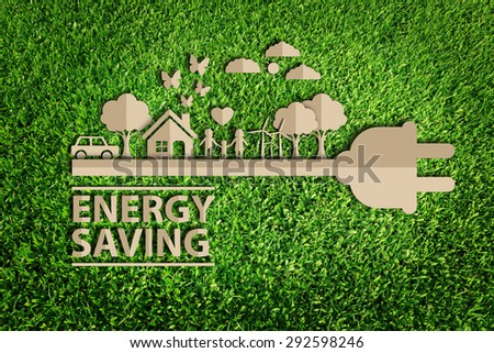energy saving.  Paper cut of eco on green grass. - stock photo