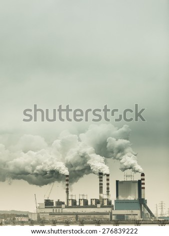 Energy. Smoke from chimney of power plant or station. Industrial landscape. Autumnal foggy day