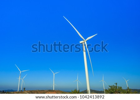 Energy windmill produce energy on blue sky at daytime