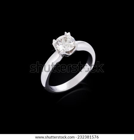Engagement diamond ring on black background - stock photo