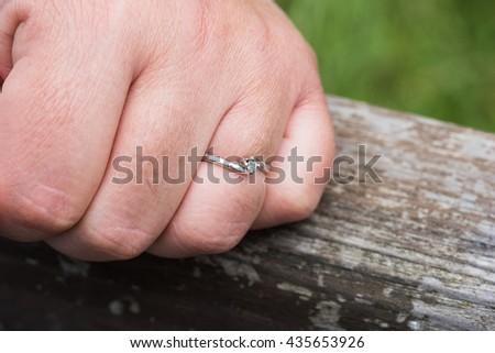 Engagement ring on her finger - stock photo