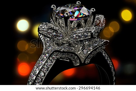 Engagement Ring with Diamond on  Jewelry dark background.