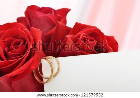Engagement rings and red roses with Valentine card