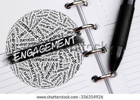 ENGAGEMENT word concept written on notebook - stock photo