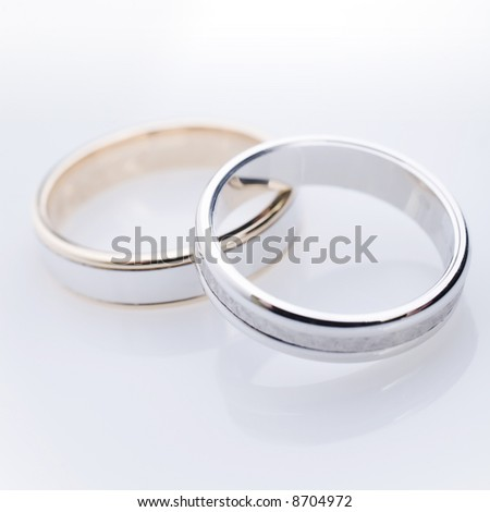 engament rings over a white reflective background