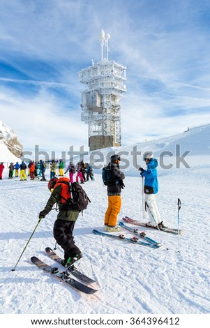 ENGELBERG, SWITZERLAND. January 18th, 2016. Skiers preparing for a downhill run from the top of Mount Titlis at minus 12 degrees Celsius. - stock photo