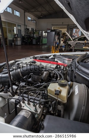 engine car in workshop for assistance in troubleshooting - stock photo