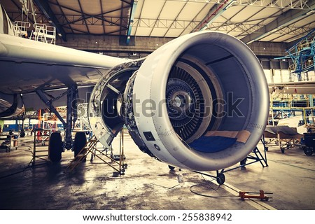 Engine of the airplane under heavy maintenance - stock photo