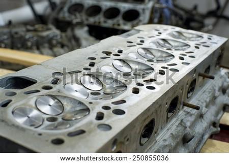 engine parts, six cylinders, twenty-four valves - stock photo