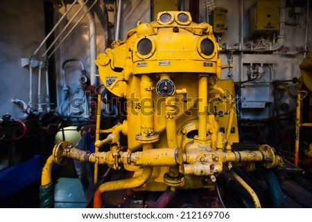 Engine room on a cargo boat ship - stock photo