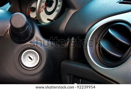 engine start key hole of a modern compact car - stock photo