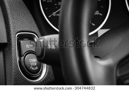 Engine start stop button in a modern passenger car. - stock photo