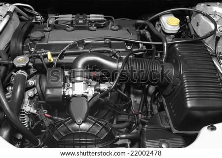 Engine under the hood of a car - stock photo