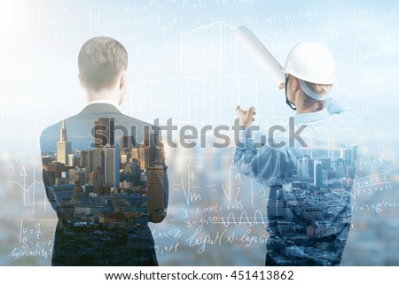 engineer and businessman looking to city under construction - stock photo