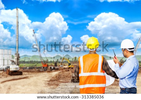 Engineer and foreman use radio communication for command working at construction site project - stock photo
