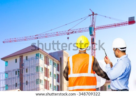 Engineer and foreman working control in construction site